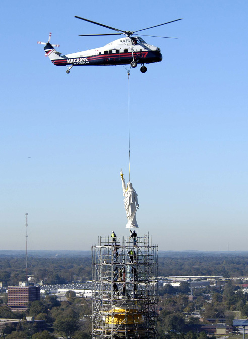 miss freedom georgia state capitol-lowerd by helicopter