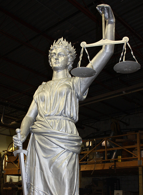 statue restoration edgar county illinois lady justice with scales of justice in shop