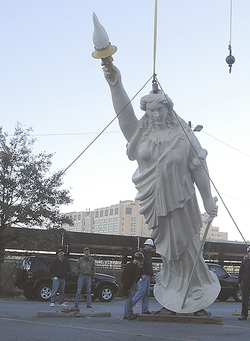 statuary restoration miss freedom georgia state capitol being lifted