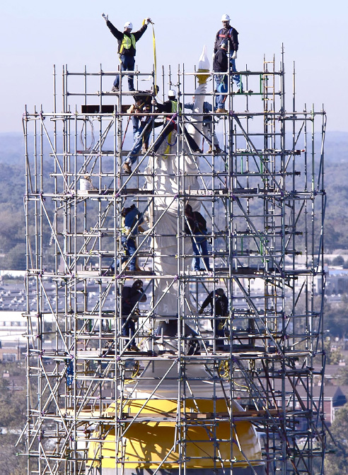 statue miss freedom surrounded by scafolding georgia state capitol